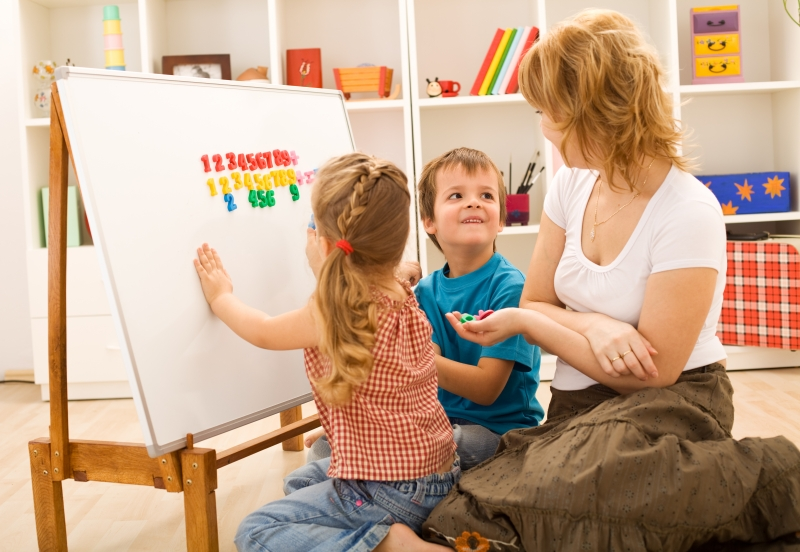 904999-kids-doing-math-exercises-with-mom